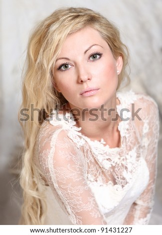 portrait of a bride with blond curly hair - stock photo