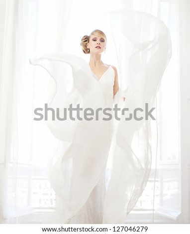 Portrait of a bride with white flowing lace - stock photo