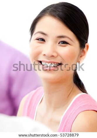 Portrait of a bright businesswoman smiling at the camera against a white background - stock photo