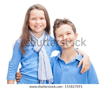 Portrait of a Brother and Sister, both wearing a blue shirt - stock photo