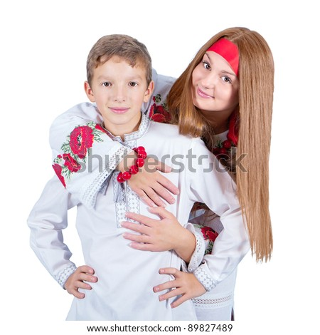Portrait of a brother and sister in the Ukrainian national costume (isolated on white) - stock photo