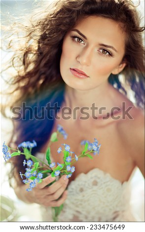 portrait of a brown-eyed sensual kinky girl in white dress on the window background, close up - stock photo