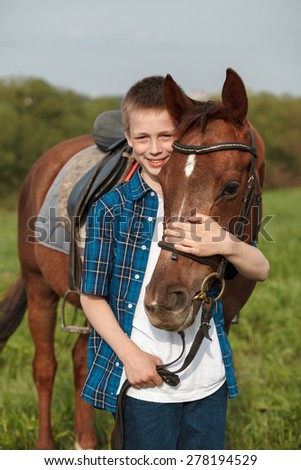 Portrait of a brown horse and boy - stock photo