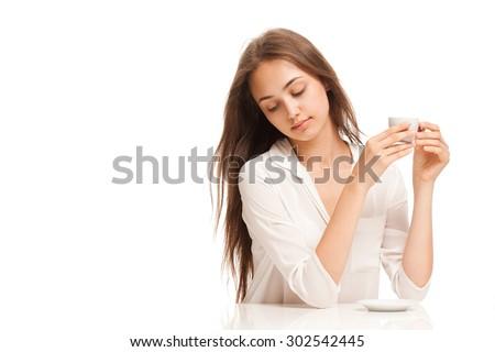 Portrait of a brunette beauty having espresso coffee. - stock photo