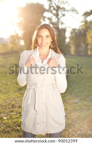 portrait of a brunette girl in autumn