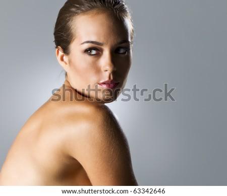 Portrait of a brunette model in a studio environment - stock photo