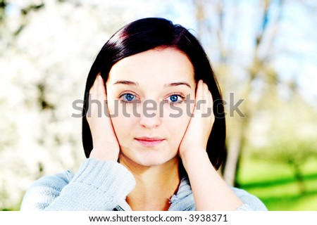 Portrait of a brunette nice girl in a park. - stock photo