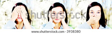 Portrait of a brunette nice girl in a park doing funny thing. - stock photo