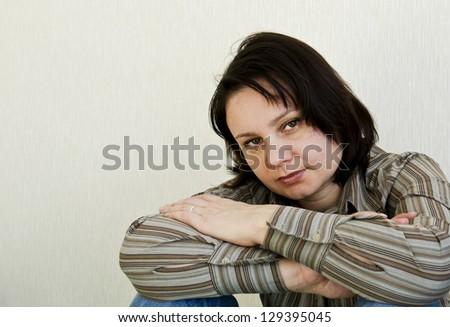 Portrait of a brunette woman - stock photo