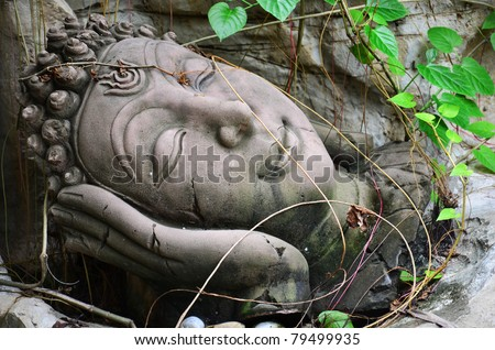 Portrait of a Buddha statue - stock photo