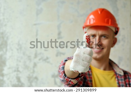Portrait of a builder in red helmet - stock photo