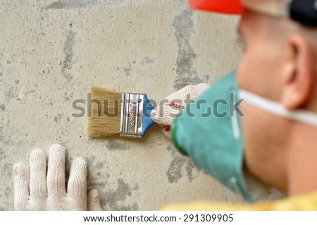 Portrait of a builder in red helmet - stock photo