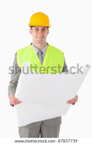 Portrait of a builder looking at a plan against a white background - stock photo