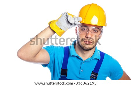Portrait of a builder wearing protective goggles and helmet - hardhat