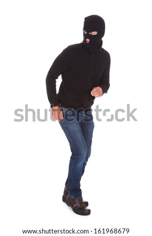 Portrait Of A Burglar Standing Isolated On White Background - stock photo