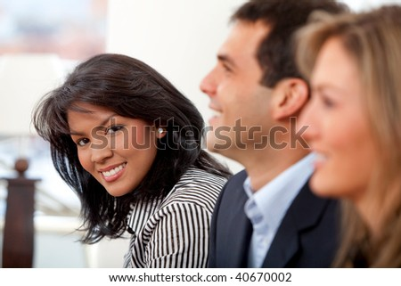 Portrait of a business group smiling at an office
