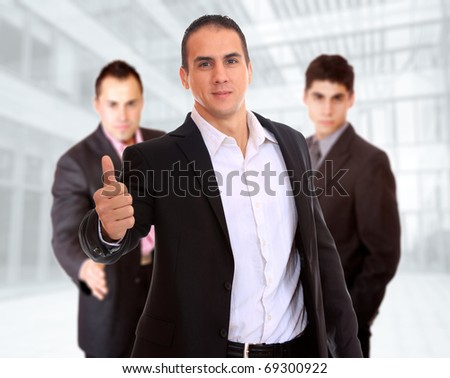 Portrait of a business man holding money isolated on white background - stock photo