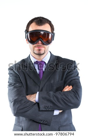 Portrait of a  business man in ski goggles isolated on white background. Studio shot. - stock photo
