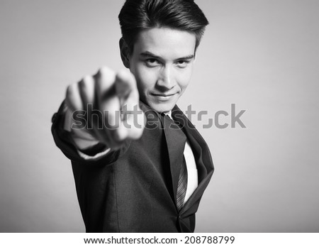 Portrait of a business man pointing with his finger. - stock photo