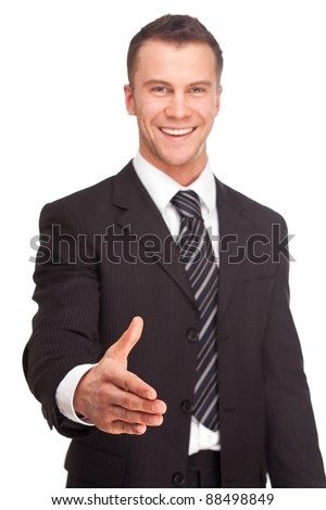 Portrait of a business man shake hand and greeting you isolated on white background. Studio shot.