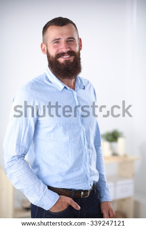 Portrait of a business man standing in office, isolated on whitebackground - stock photo