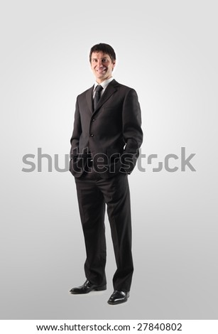 portrait of a business man standing isolated on a white background - stock photo