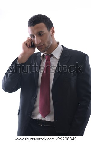 Portrait of a business man talk with cell mobile  phone isolated on white background. Studio shot communication concept - stock photo