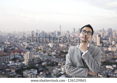 Portrait of a business man thinking - stock photo
