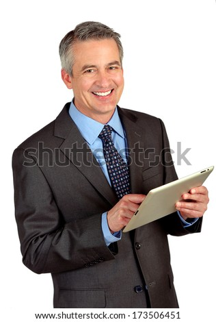 Portrait of a business man using a tablet - stock photo