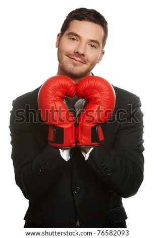 Portrait of a business man wearing boxing-gloves isolated on white - stock photo