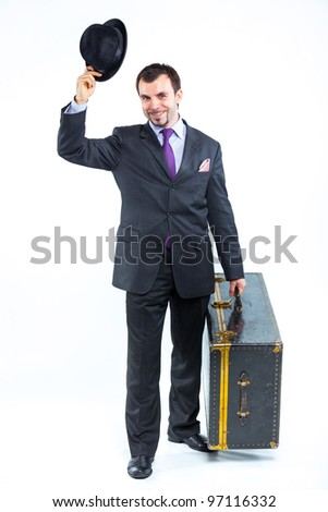 Portrait of a  business man with big old suitcase isolated on white background. Studio shot.