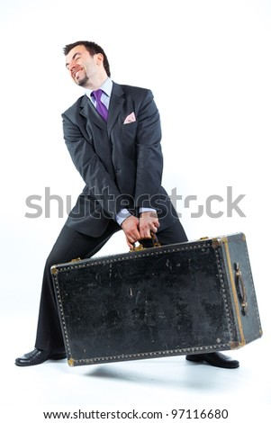 Portrait of a  business man with big old suitcase isolated on white background. Studio shot. - stock photo