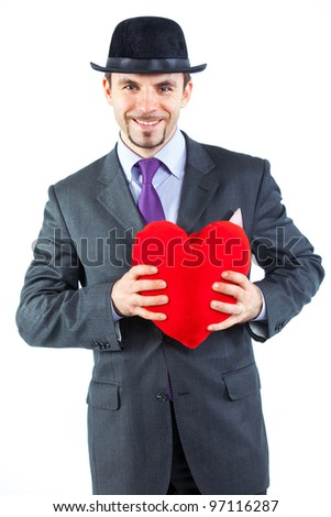 Portrait of a business man with hat and red heart isolated on white background. Studio shot. - stock photo