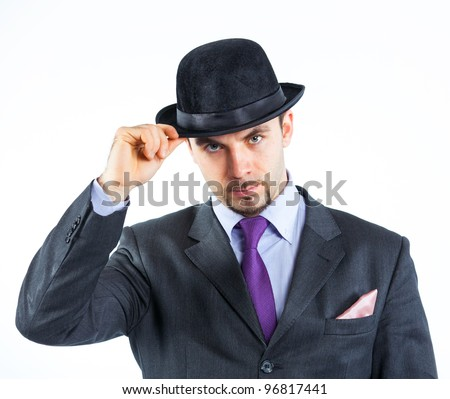 Portrait of a business man with hat isolated on white background. Studio shot. - stock photo