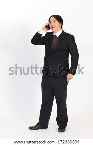 Portrait of a business man with phone isolated on white background
