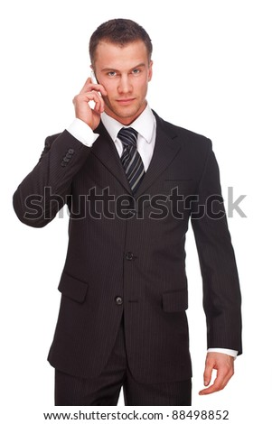 Portrait of a business man with phone isolated on white background. Studio shot. - stock photo