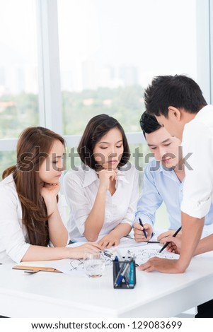 Portrait of a business team brainstorming at office - stock photo