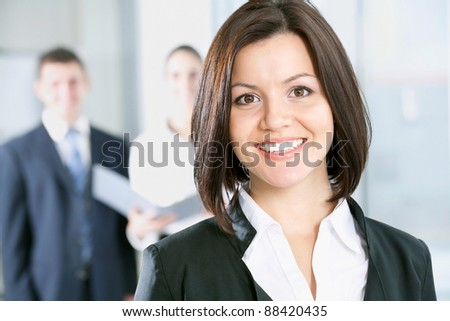Portrait of a business woman and her colleagues at the background - stock photo