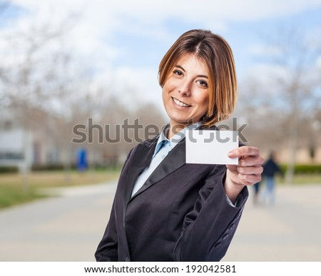 portrait of a business woman holding a white card