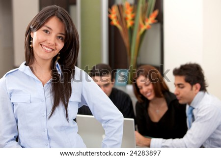 Portrait of a business woman in an office smiling