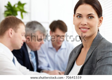 Portrait of a business woman looking at camera and smiling