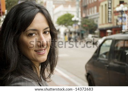 Portrait of a business woman on a city street - stock photo