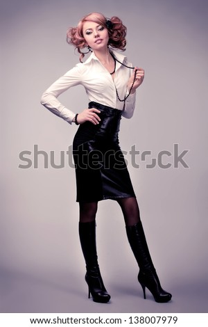 portrait of a business woman on the gray background - stock photo