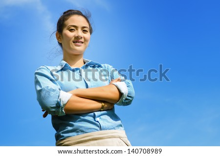 Portrait of a business woman with blue sky - stock photo