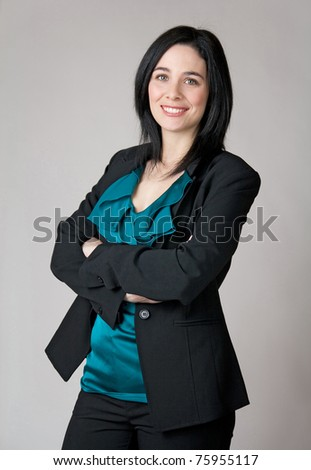 Portrait of a business woman with her arms crossed. - stock photo