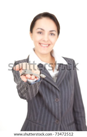 portrait of a business woman with key, focus on the keys - stock photo