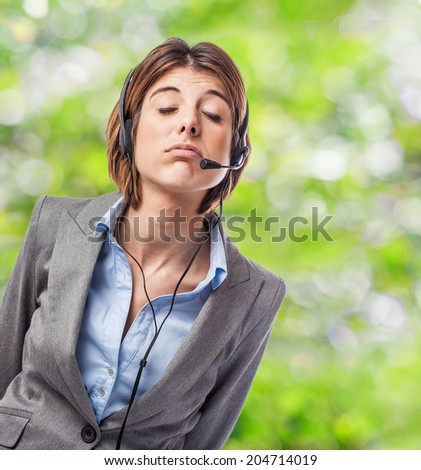 portrait of a business young woman talking on headphones - stock photo