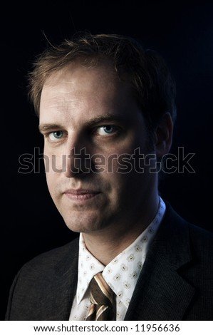 Portrait of a businessman, a serious look on his face.