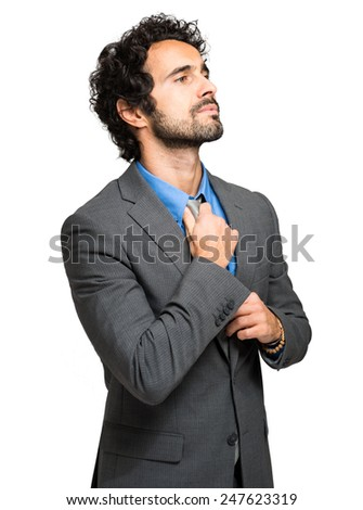 Portrait of a businessman adjusting his tie  - stock photo