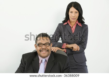 Portrait of a businessman and a businesswoman - stock photo